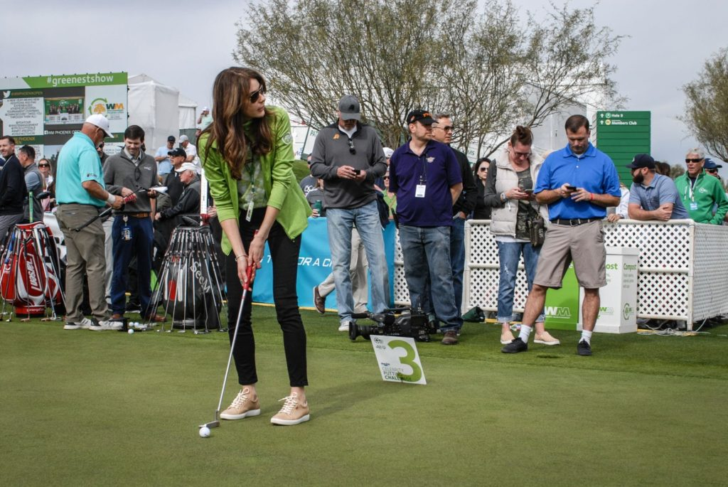 Celebrity putting challenge participant golfing