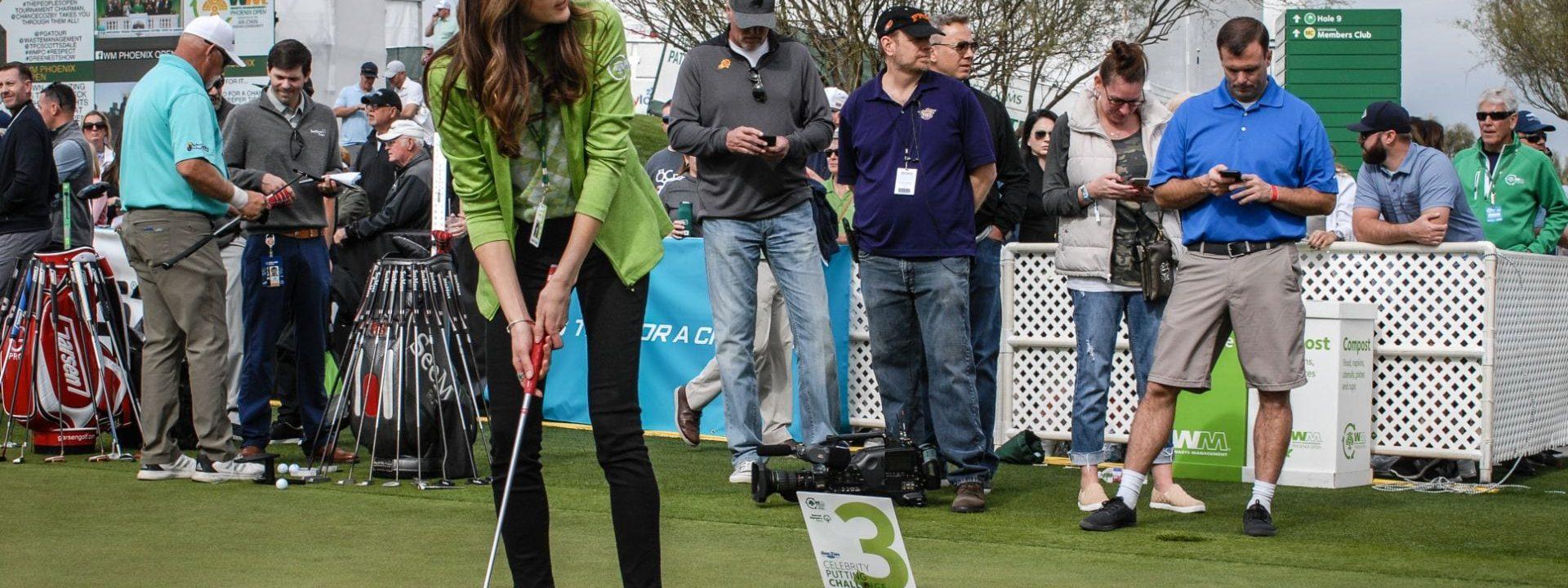 Celebrity putting challenge participant golfing